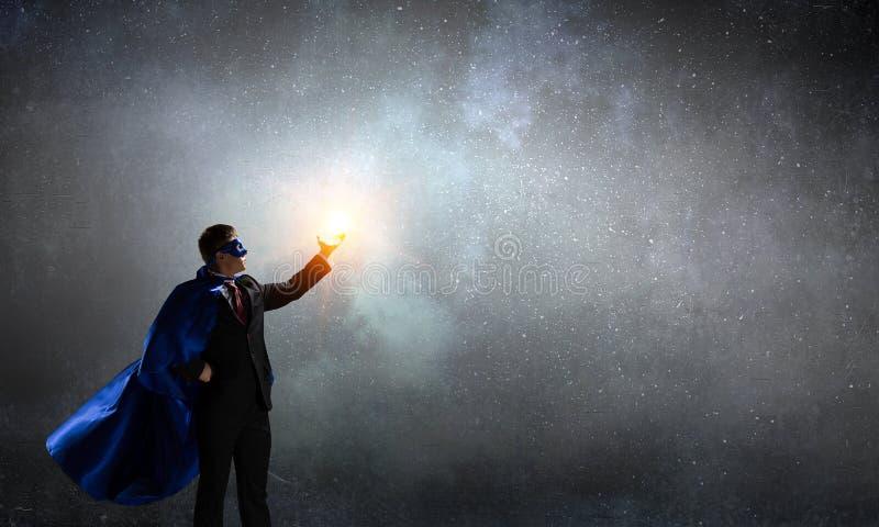 Uomo eccellente in cielo Media misti fotografia stock libera da diritti