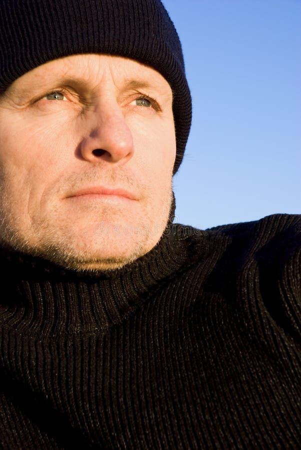 Uomo esterno sembrante Pensive fotografia stock