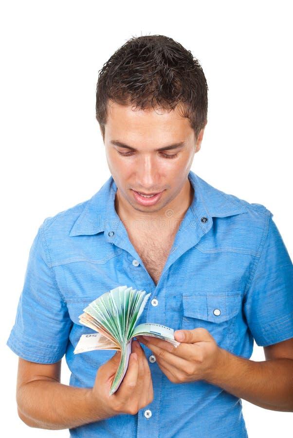 Uomo felice che conta soldi immagine stock