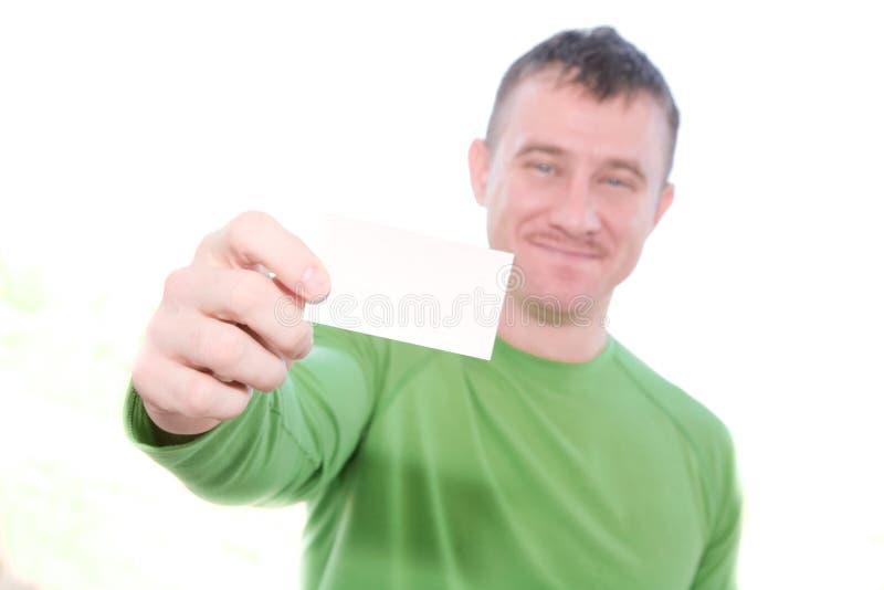 Uomo felice che tiene scheda in bianco immagini stock