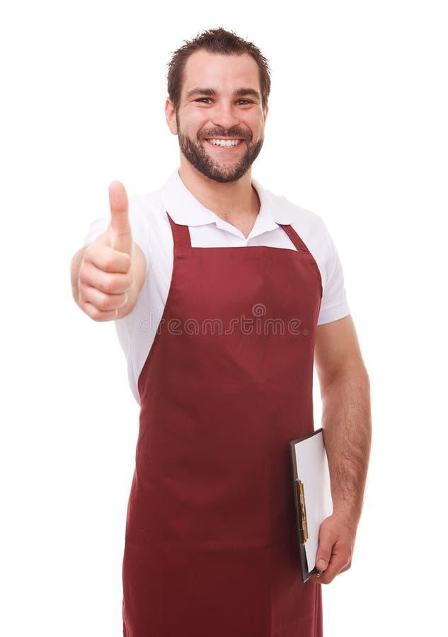 Uomo felice con il grembiule rosso fotografia stock