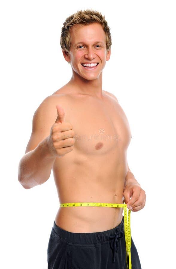 Uomo felice con nastro adesivo di misurazione immagini stock libere da diritti