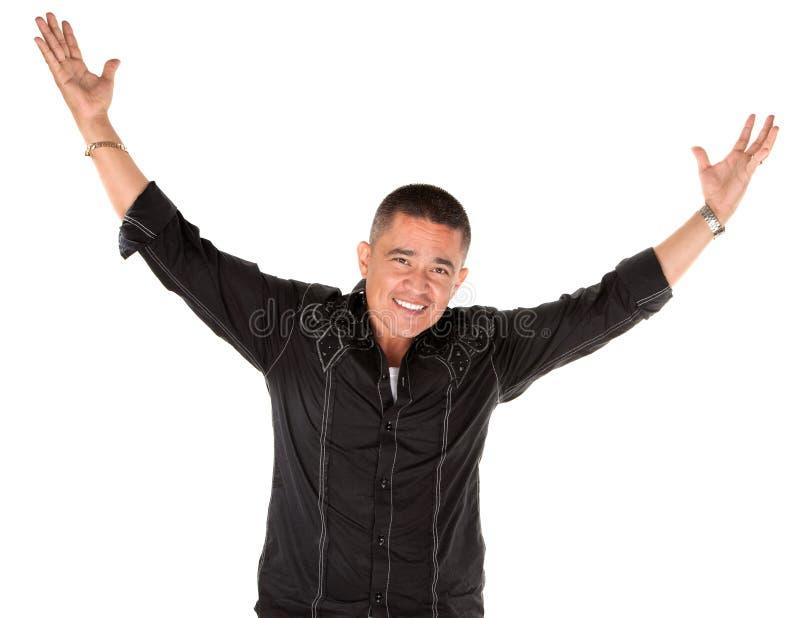 Uomo felice del latino con le braccia alzate fotografia stock libera da diritti