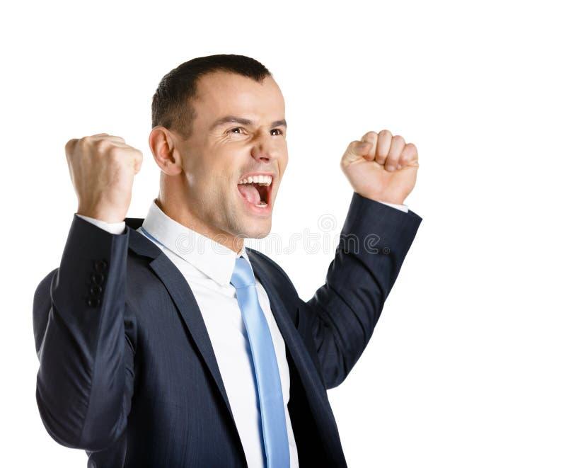 Uomo felice di affari con i pugni su immagine stock