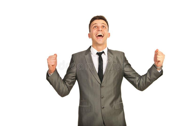 Uomo felice di affari del vincitore immagini stock