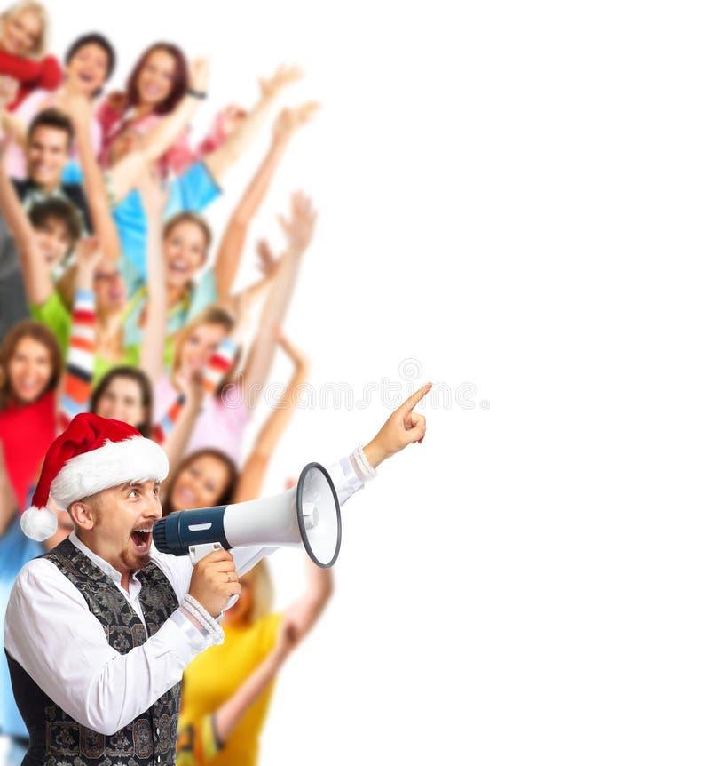 Uomo felice di Santa che parla dentro rumoroso-hailer fotografia stock libera da diritti