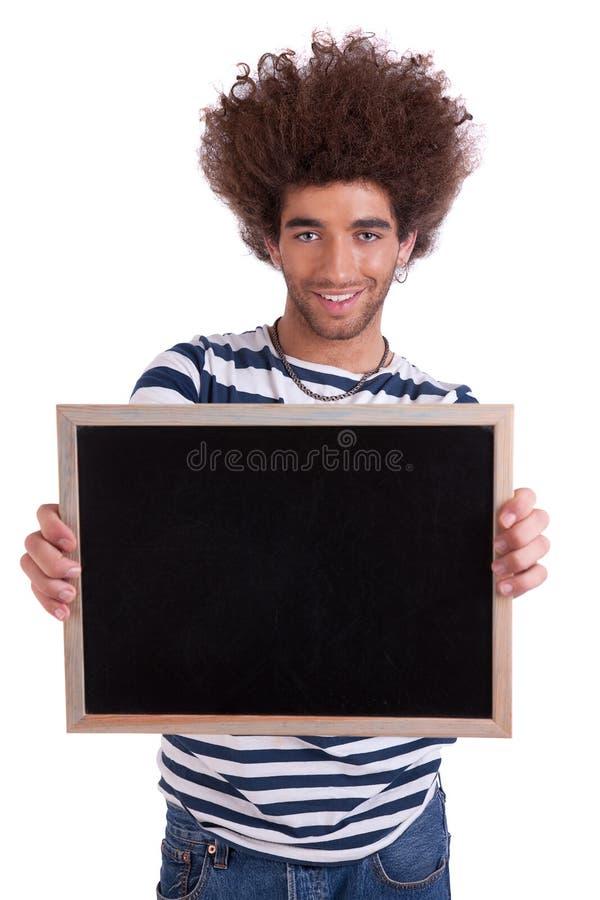 Uomo felice e bello che tiene una scheda nera immagini stock libere da diritti