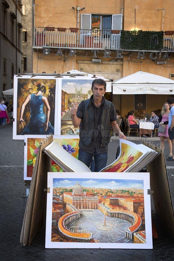 Uomo fiero con la sua pittura fotografia stock