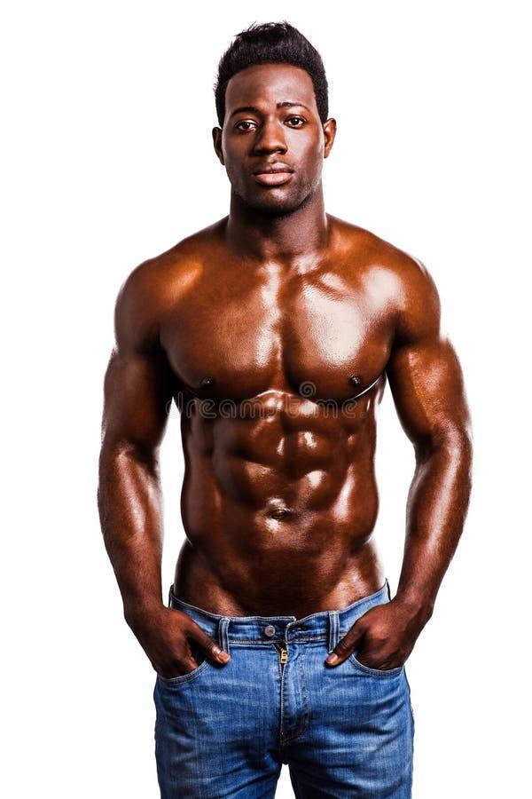 Uomo forte senza camicia che posa nello stile immagini stock