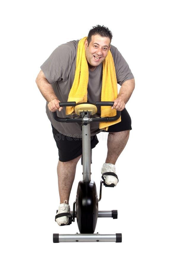 Uomo grasso che gioca sport fotografia stock