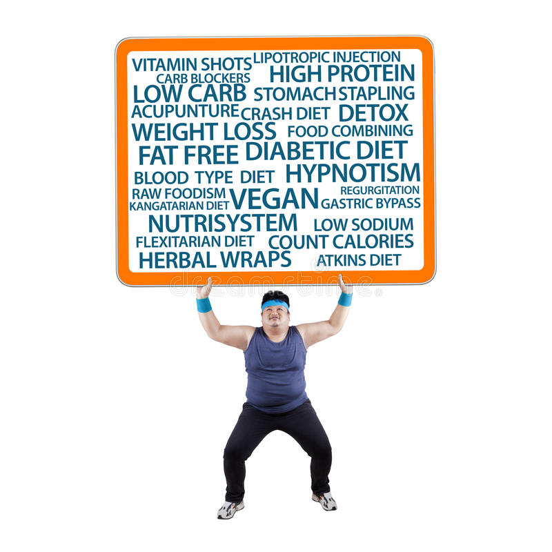 Uomo grasso che solleva un tabellone per le affissioni fotografie stock