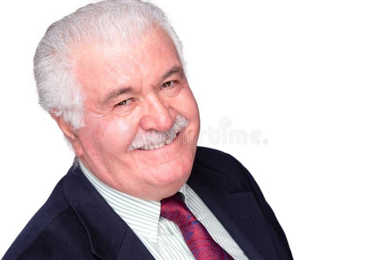 Uomo grigio-dai capelli anziano carismatico gioviale immagini stock libere da diritti