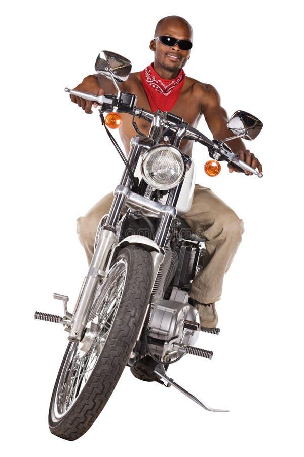 Uomo isolato sulla motocicletta immagini stock libere da diritti