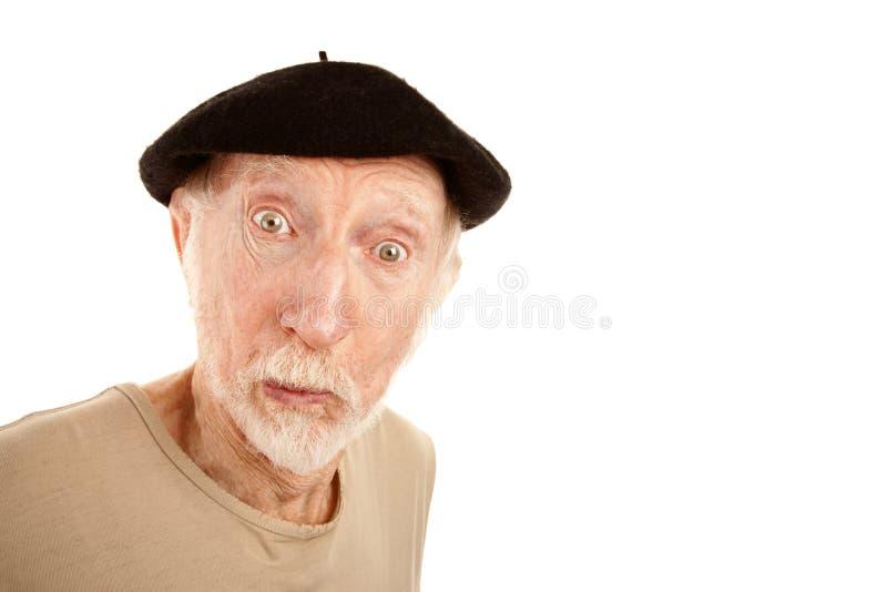 Uomo maggiore in berreto nero fotografia stock libera da diritti