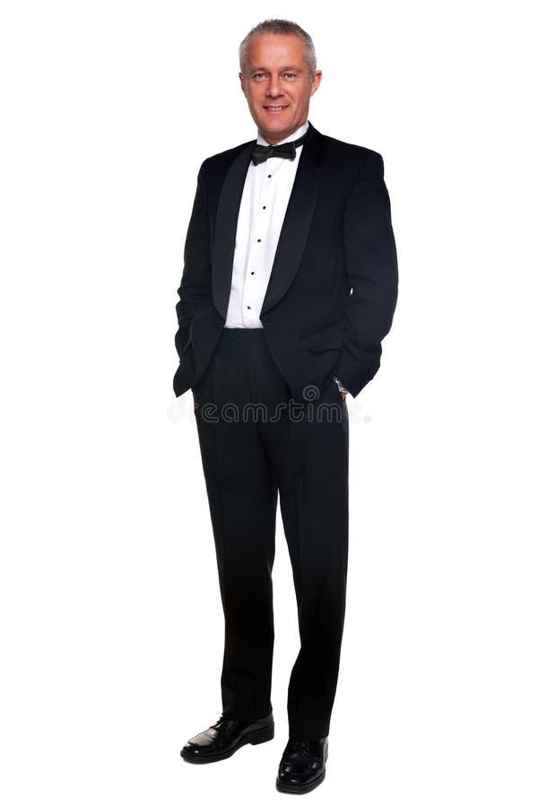 Uomo maturo in smoking ed in legame nero. fotografie stock libere da diritti