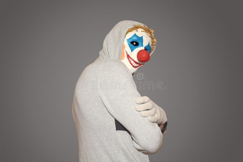 Uomo nel pagliaccio di malvagità della maschera fotografie stock
