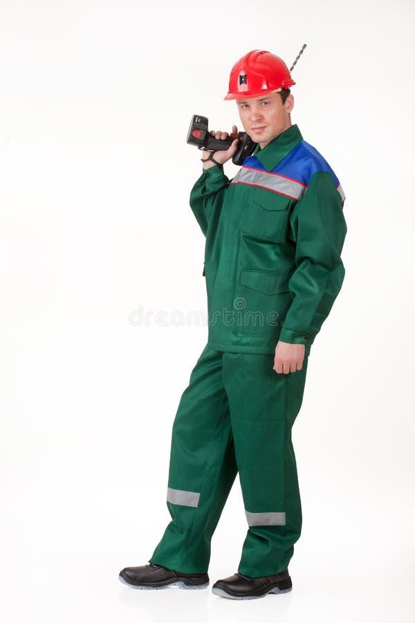 Uomo nell'uniforme con il trapano immagini stock libere da diritti