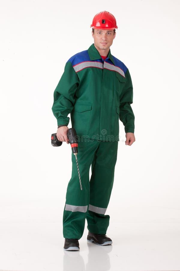 Uomo nell'uniforme con il trapano immagine stock libera da diritti