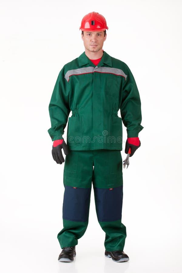 Uomo nell'uniforme con una chiave fotografia stock libera da diritti