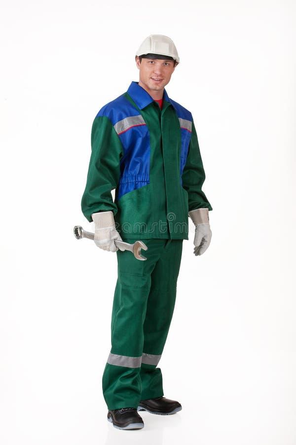 Uomo nell'uniforme con una chiave fotografie stock