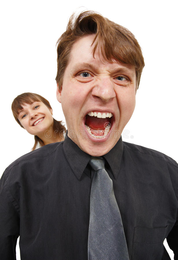 Uomo nella collera e gridato fortemente. Donna felice. immagini stock libere da diritti