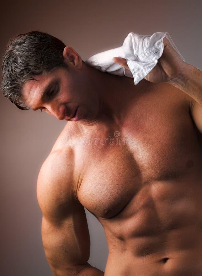 Uomo nudo con la camicia fotografia stock