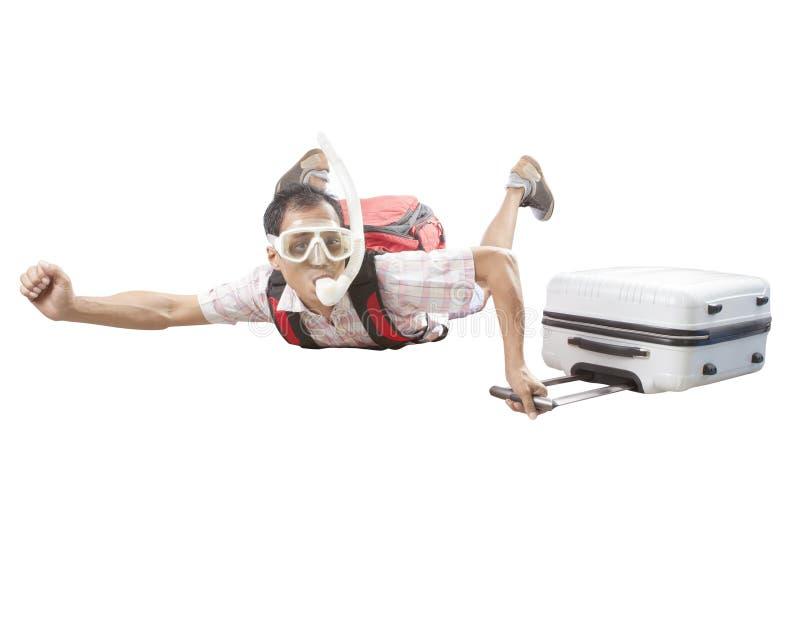 Uomo pazzo che dura immergendosi maschera che pilota metà di aria con il viaggio immagine stock