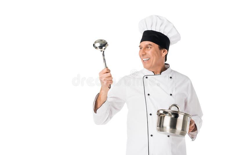 Uomo in pentola e siviera della tenuta dell'uniforme del cuoco unico fotografia stock