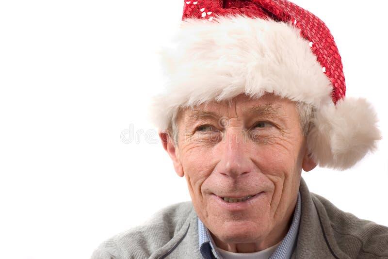 Uomo più anziano sorridente con il cappello della Santa immagini stock