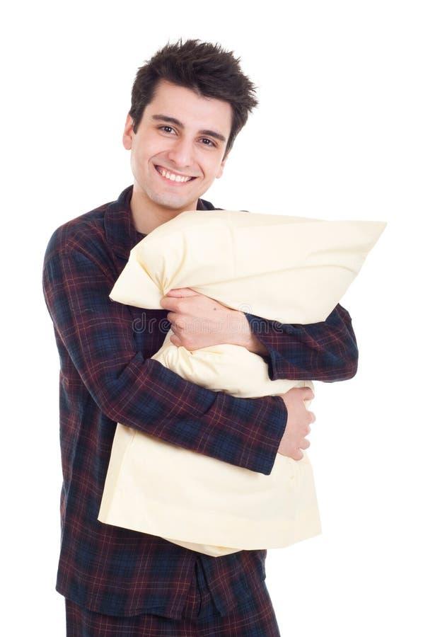 Uomo in pigiami che tengono cuscino fotografia stock