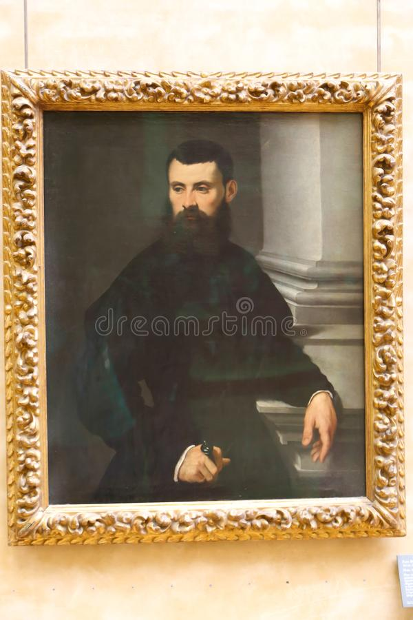 Uomo - pittura antica famosa nel museo del Louvre fotografia stock