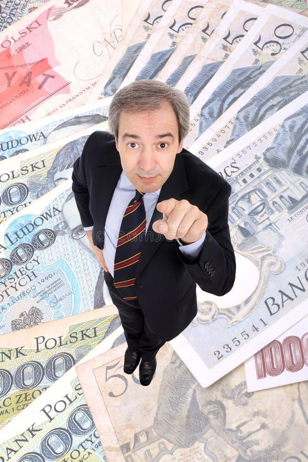 Uomo ricco di affari che indica in su fotografia stock