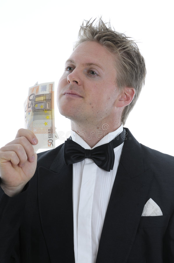 Uomo ricco in rivestimento di pranzo fotografia stock libera da diritti