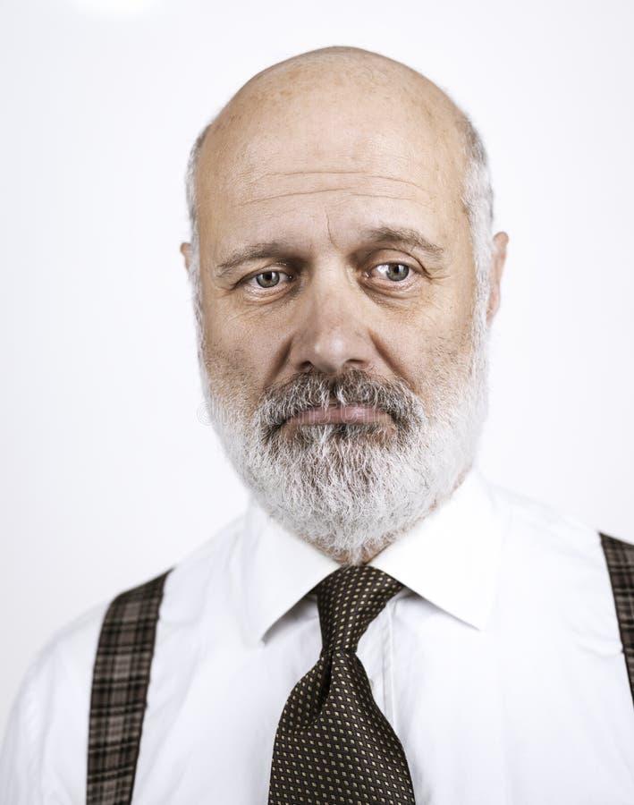 Uomo senior deludente su fondo bianco fotografia stock libera da diritti
