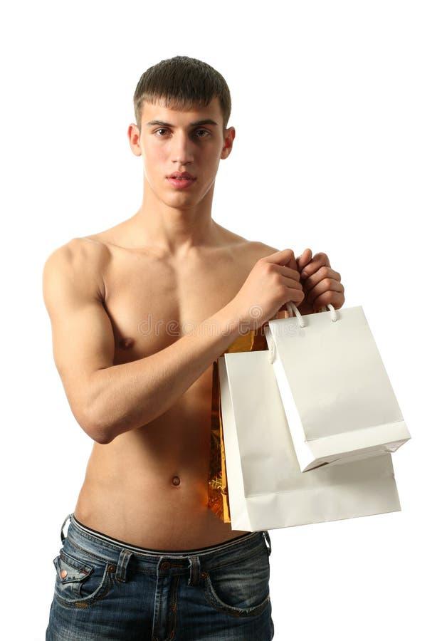 Download Uomo Sexy Con I Sacchetti Di Acquisto Dello Spazio Della Copia Immagine Stock - Immagine di maschio, cliente: 7303323
