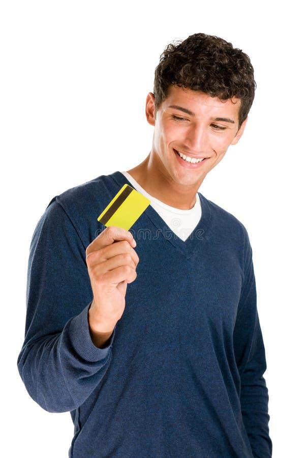 Uomo soddisfatto con la carta di credito immagini stock libere da diritti