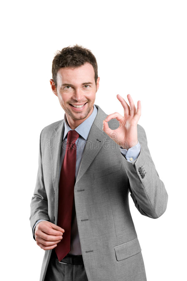 Uomo soddisfatto di affari che mostra segno giusto immagini stock