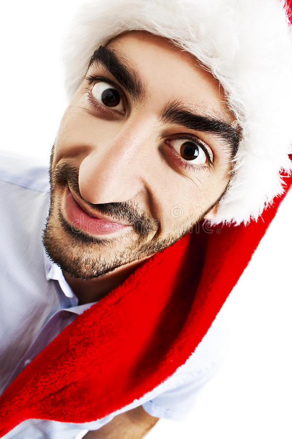 Uomo sorridente in cappello del Babbo Natale immagine stock