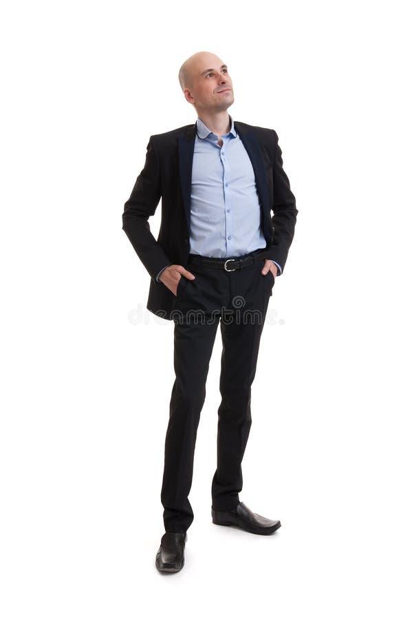 Uomo sorridente di affari che sta integrale fotografia stock
