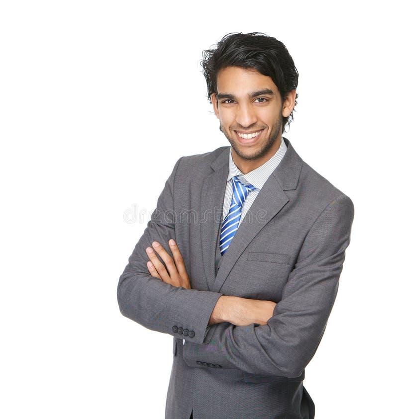Uomo sorridente di affari con le armi attraversate immagine stock