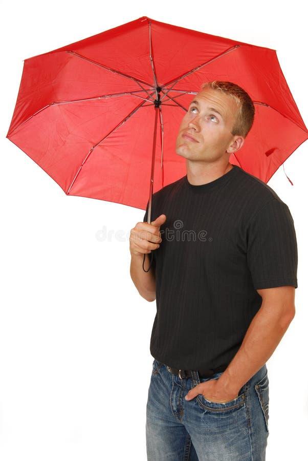 Uomo sotto un ombrello fotografia stock