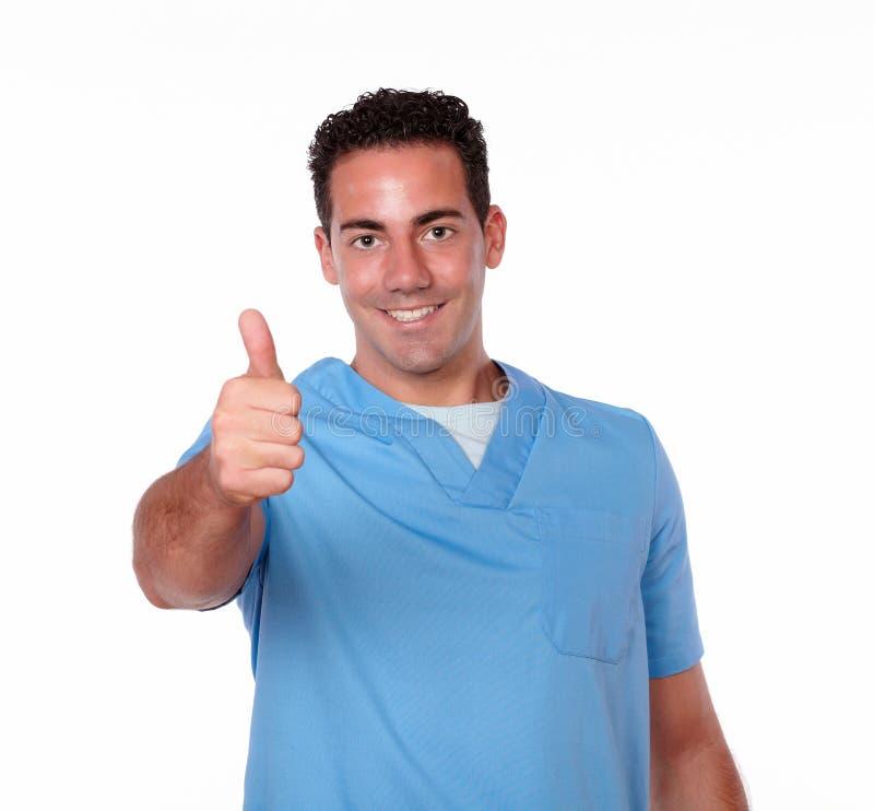 Uomo splendido dell'infermiere con il segno giusto immagini stock