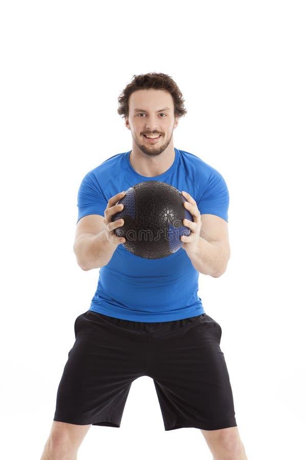 Atleta con palla medica fotografia stock