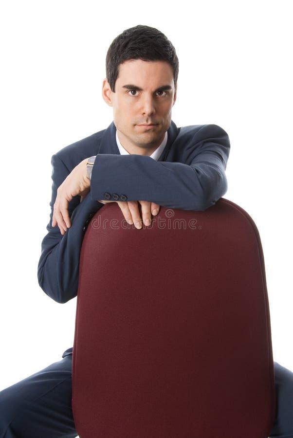 Uomo su una presidenza fotografia stock libera da diritti