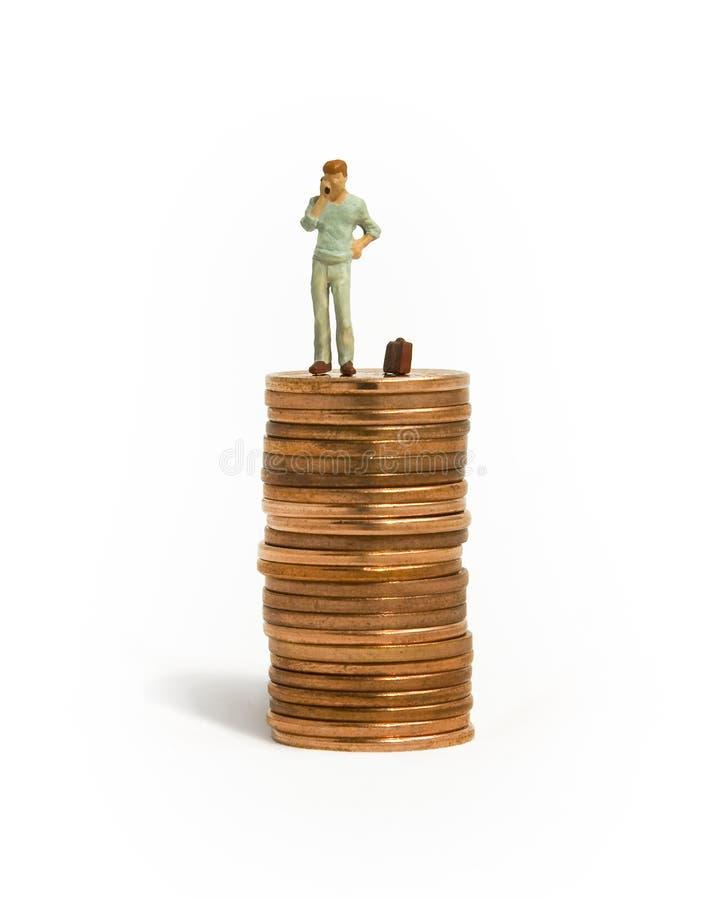 Uomo sui penny immagine stock