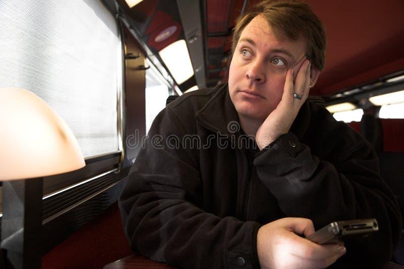 Uomo sul treno immagine stock