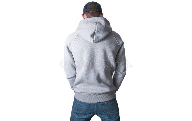 Uomo, tipo in maglia con cappuccio grigia in bianco, maglietta felpata, derisione su isolata Pla fotografia stock libera da diritti