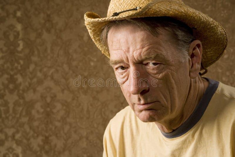 Uomo in un cappello del cowboy fotografia stock libera da diritti