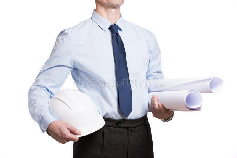 Uomo in un casco blu con i disegni isolati su bianco fotografie stock libere da diritti