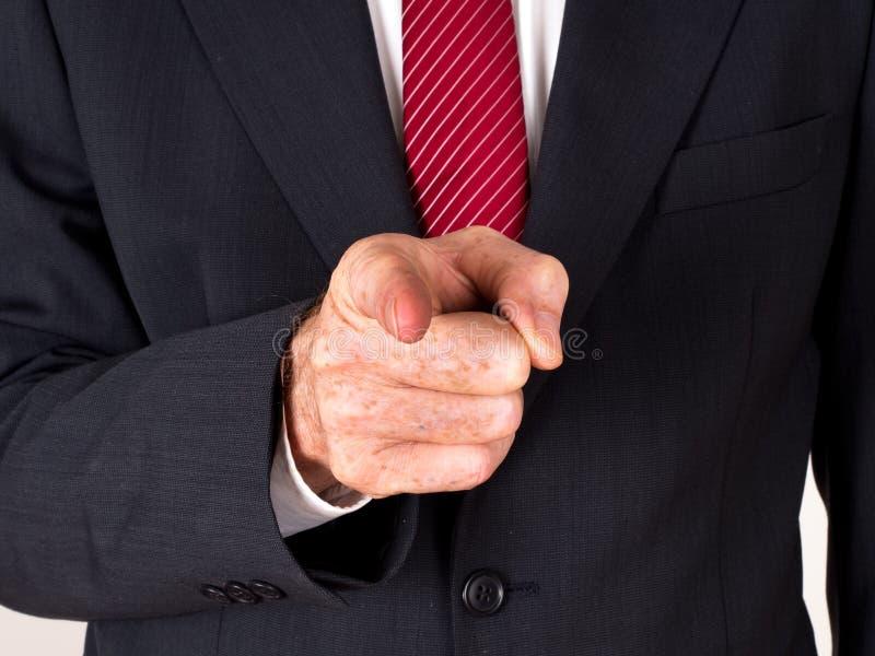Uomo in vestito che indica - sporgenza, bossy fotografia stock